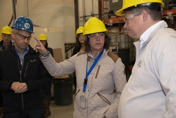EM Assistant Secretary Anne White, center, talks to Brian Brendel, president of Columbia Energy and Environmental Services, right, as Rob Hastings, assistant manager, Hanford Office of River Protection Tank Farms, looks on. White visited Hanford to get an