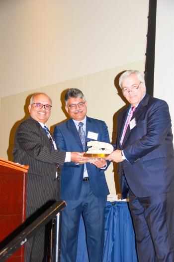 Angelos accepts his award