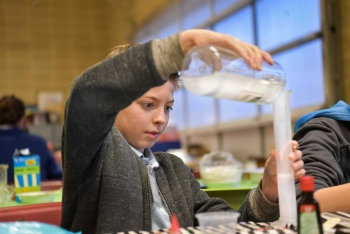 An Albuquerque middle school student enjoys some hands-on science activities as part of Sandia National Laboratories' Manos program.
