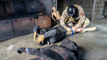 One participant in the NNSA active shooter exercise at the Hanford Site said the intense realism is what made the exercise effective. Here, an officer applies a tourniquet to a role player once the immediate threat has been eliminated.