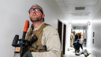 "The workshop was designed to address inconsistencies among active shooter and workplace violence plans at NNSA's labs, plants, and sites. Here, a participant establishes hallway security in a ""warm zone"" to allow entry by a rescue task force."