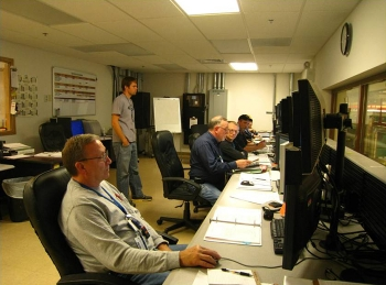 Depleted Uranium Hexafluoride Conversion Project technicians monitor conversion facilities from a plant control room.