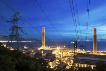 An electrical power plant at night.