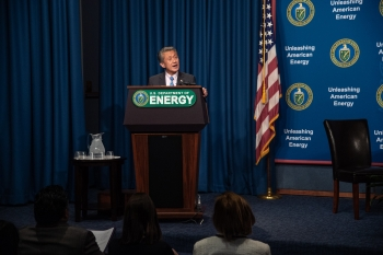 Special Secretary Jimmy Rhee speaks at the podium.