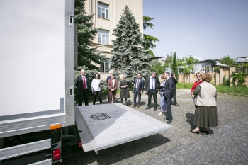The partners inspect the security features of the vehicle at the Georgian Ministry of Environment Protection and Agriculture in Tbilisi, the capital.