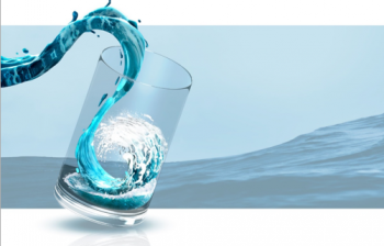 An illustration of a wave of water filling a glass with ocean waves in the background.