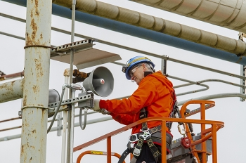 EM Paducah Site Electrician Steve Atherton installs electronic horns for the criticality accident alarm system to replace the air-powered horns that have been used since the 1990s.