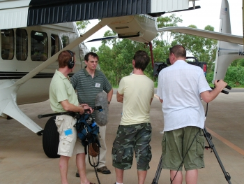 Jim Mather discusses research into tropical clouds with a news crew during a 2006 media day jointly organized by ARM and the Australian Bureau of Meteorology.