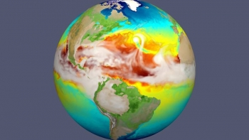 In the North-Central Atlantic Ocean near the center of the simulation snapshot, a hurricane is visible as a dot of gray and from the cold water (green) it stirred up in the otherwise warm (red) Central Atlantic Ocean.