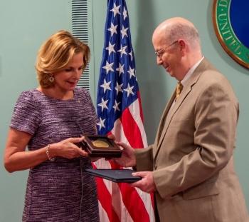 NNSA Administrator Lisa E. Gordon-Hagerty presents the Administrator's Gold Service Award to DOE's Robert Lingan.