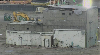 Before-and-after photos show how workers safely removed a concrete vault associated with the Plutonium Finishing Plant's Main Processing Facility. Demolition began in April and was completed in mid-May.