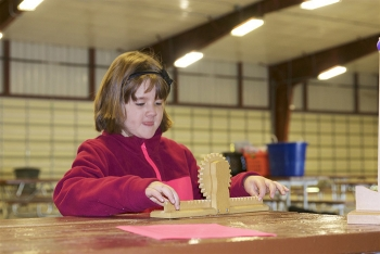A student learns about gears at the recent Fluor Idaho STEAM Days at the Idaho Falls Zoo.
