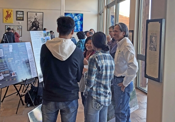 Bill Frazier (LM) and May Picel (Argonne National Laboratory) discuss the Riverton, Wyoming, Site with students at a Northern Arapaho event.