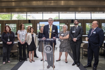 NNSA Associate Administrator for Management and Budget Frank Lowery and members of the PNNL fellowship management team welcome guests to the NGFP graduation reception.