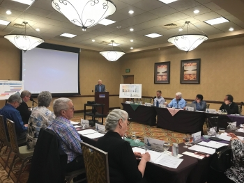 Richard Stallings, former U.S. Congressman and Nuclear Waste Negotiator, delivers a presentation to the CAB recounting his experience with nuclear waste negations during the April 25 public meeting