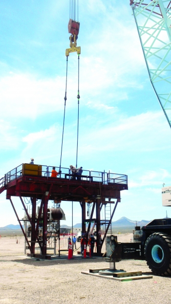 A crane helps prepare one part of the Source Physics Experiment in 2018.