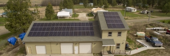 Photo of a Spokane Tribe house with solar panels on the roof.