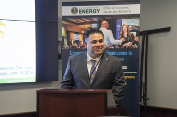 Honorable James E. Campos smiling at the podium