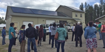 People take a tour to see the solar panel installation.