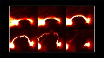 """Rapidly accelerating kink instability (arch shape) of a plasma jet produces an effective gravity that causes """"ripples"""" (seen on bottom of the arch). The ripples choke the jet at which time a burst of 6 kilovolt X-rays is observed."""