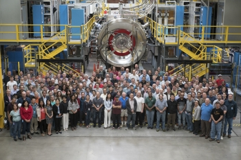 Norman w/ the TAE Technologies team in the foreground for scale. The project is the world's largest private fusion effort, with more than 160 scientists representing 35 countries. Seen here is one of two identical outer diverters on either side of Norman.