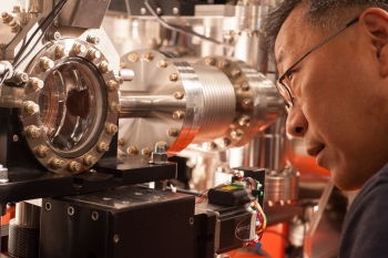 "Yiping Feng and the SRD X-RAY ""Single Shot"" detector in LCLS's Front End Enclosure (FEE) Hall."