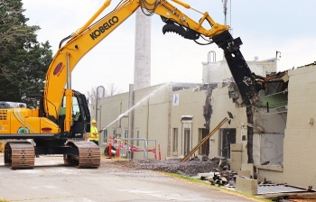 Workers demolish the west portion of Building 3017 at the Oak Ridge Site.