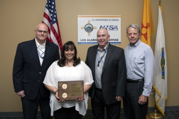 Marie Griego receives her NNSA Bradley A. Peterson Federal Security Professional of the Year award.