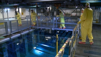 Operators use a monorail at the Savannah River Site to move a fuel rod horizontally under water. New improvements will allow fuel to be moved vertically, realizing a 25-percent efficiency gain in fuel movement.