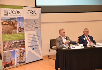 UCOR President and CEO Ken Rueter speaks at the 2019 East Tennessee Workforce Summit about his company's approach to workforce development. Tennessee State Rep. John Ragan is at right.