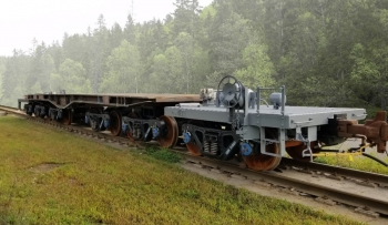 Image of part of a train on track trains.
