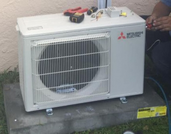 Photo of the mini-existing heat pump outside.