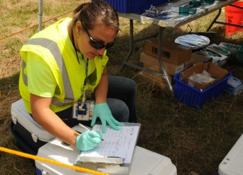 A technician enters environmental media data into report records as part of DOE's Portsmouth Environmental Monitoring program.