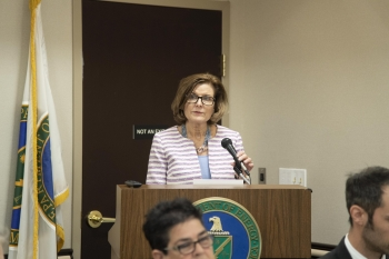 Principal Deputy Director of the Office of Economic Impact and Diversity Ann Augustyn speaks at the podium