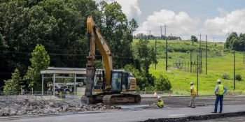 Oak Ridge Site workers remove asphalt and concrete on the east end of the Y-12 National Security Complex to prepare the site of the Mercury Treatment Facility's treatment plant.