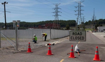 Employees installed fences and barriers to identify the boundaries of the Mercury Treatment Facility's treatment plant and headworks facility, ensuring safety and security.