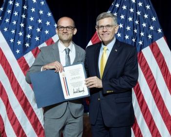 Timothy Silverman with Kelvin K. Droegemeier