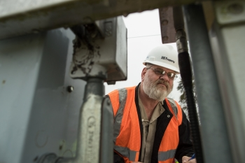 A technician checks air-monitoring equipment at the Portsmouth Site.