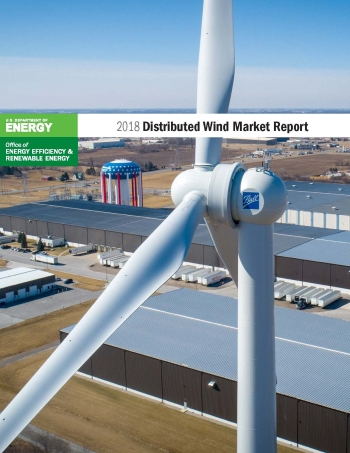 Aerial photograph of a turbine near an industrial facility that serves as a report cover.