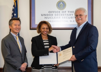 Dr. William Bookless, Principal Deputy Administrator of NNSA and Steven Ho, Director, Cost Estimating and Program Evaluation, presented Betty T. Morrison with a certificate for your 20 years of service in the federal government.