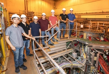 Pre-apprentices in the National Spherical Torus Experiment-Upgrade test cell. L-R: Brian Rivera, East Windsor; Purdy; Nelson Espinal, NY; Robert Bongiovanni, Hamilton; Aaron Floyd, Lawrenceville; Cole Widman, Hopewell Township, Sheehan Twomey, Princeton.