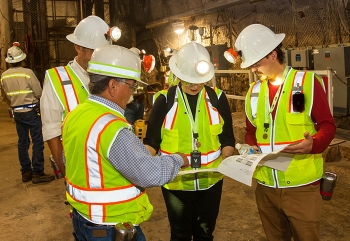 Members of a panel of mine experts tour the underground at the Waste Isolation Pilot Plant on a visit to the facility this month.
