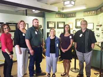 New Oak Ridge Site Specific Advisory Board members, from left, Georgette Samaras, Amy Jones, Noah Keebler, Harriett McCurdy, Andrea Browning, and Robert Whittaker visit the historic Graphite Reactor at Oak Ridge National Laboratory.