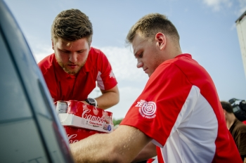 DOE Interns Kyle Garner and James Kelly help organize loads of food going to local nonprofits.
