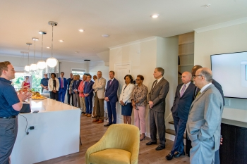 Representatives from DOE, Southern Company, Georgia Power, PutleGroup, Georgia Public Service Commissioners, EPRI, and the City of Atlanta join the new homeowners on a tour of a smart town home in the Altus community.