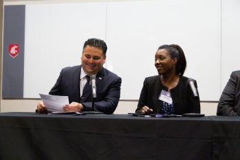 Director James E. Campos and President and CEO Paula Glover laugh