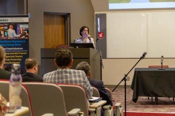 Sandra Haynes, Ph.D. speaking at the podium