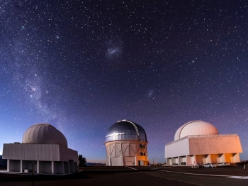 Researchers used the Blanco telescope in conducting the Dark Energy Survey. The Milky Way is on the left of the sky, with the Magellanic clouds in the center.