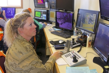 An employee monitors work in the Accelerated Retrieval Project V facility at DOE's Idaho National Laboratory Site in real time from a nearby trailer.