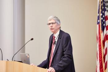 Dr. Charles Verdon delivering the keynote address at the 2019 CECOP.